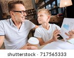 pre teen boy asking his father... | Shutterstock . vector #717565333
