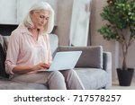 nice aged woman using her... | Shutterstock . vector #717578257