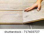 laying laminate flooring in a... | Shutterstock . vector #717603727