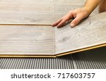 laying laminate flooring in a... | Shutterstock . vector #717603757