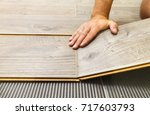 laying laminate flooring in a... | Shutterstock . vector #717603793