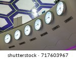 a row of clocks in an airport ... | Shutterstock . vector #717603967