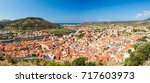 colorful river and houses with... | Shutterstock . vector #717603973