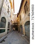 beautiful narrow street with... | Shutterstock . vector #717604003