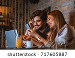 beautiful young couple in cafe. | Shutterstock . vector #717605887