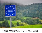 national border roadsign... | Shutterstock . vector #717607933