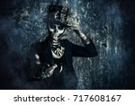 Stock photo close up portrait of a man with a skull makeup dressed in a tail coat and a top hat baron saturday 717608167