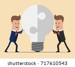 two businessmen unite lamp of... | Shutterstock .eps vector #717610543