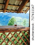Small photo of View from Alcove in the mountains, glass of beer on a table