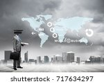 businessman with camera instead ... | Shutterstock . vector #717634297