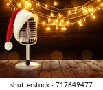 microphone with santa hat and... | Shutterstock . vector #717649477