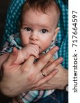 baby boy with fingers in mouth... | Shutterstock . vector #717664597