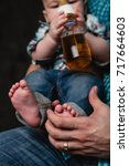 father's hand holding baby boy... | Shutterstock . vector #717664603