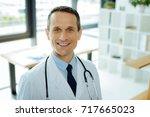 portrait of a professional... | Shutterstock . vector #717665023
