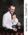 studio portrait of father and... | Shutterstock . vector #717665713
