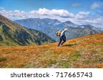 tourist with yellow backpack... | Shutterstock . vector #717665743