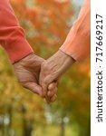 elderly couple holding hands   Shutterstock . vector #717669217