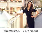 gorgeous female model with red... | Shutterstock . vector #717673303