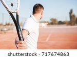 tennis. young man playing... | Shutterstock . vector #717674863