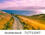 person walking on a path in... | Shutterstock . vector #717711547
