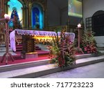 Small photo of Negros Oriental, Philippines; September 17, 2017: Elaborate flower arrangements adorn the altar every Sunday mass at the Our Lady of the Abandoned Parish in the municipality of Valencia.