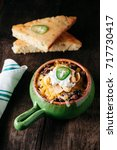 southern beef chili with cheese ... | Shutterstock . vector #717730417
