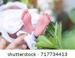 closeup of newborn baby | Shutterstock . vector #717734413