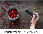 Hand With Berries In Mortar Fo...