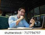 emotional programmer excited... | Shutterstock . vector #717756757