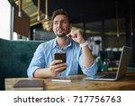 pensive male entrepreneur... | Shutterstock . vector #717756763
