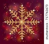 xmas golden snowflake on bright ...   Shutterstock .eps vector #717762673