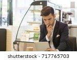 curious young businessman... | Shutterstock . vector #717765703