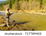 trout fishing in the mountain... | Shutterstock . vector #717789403
