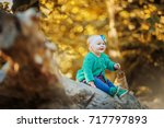 little baby in the autumn forest | Shutterstock . vector #717797893