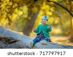 little baby in the autumn forest | Shutterstock . vector #717797917