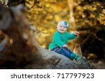 little baby in the autumn forest | Shutterstock . vector #717797923