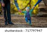 little baby learns to walk ... | Shutterstock . vector #717797947