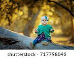 little baby in the autumn forest | Shutterstock . vector #717798043