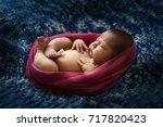 a tender newborn baby wrapped... | Shutterstock . vector #717820423