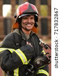 portrait of smiling fireman... | Shutterstock . vector #717832867