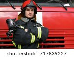 portrait of fireman wearing... | Shutterstock . vector #717839227