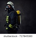studio portrait of firefighter... | Shutterstock . vector #717845383
