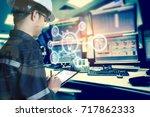 double exposure of engineer or... | Shutterstock . vector #717862333