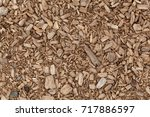 brown shredded wood as mulch... | Shutterstock . vector #717886597