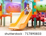 asian kid and plastic slide on... | Shutterstock . vector #717890833