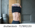 athletic man showing muscular... | Shutterstock . vector #717892153
