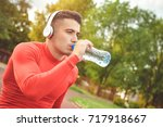 athletic sport man drinking... | Shutterstock . vector #717918667