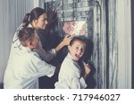 family is helping dad and girl... | Shutterstock . vector #717946027