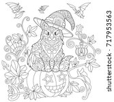 coloring page of cat in a hat... | Shutterstock .eps vector #717953563