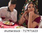 beautiful young couple sitting... | Shutterstock . vector #717971623